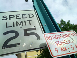 Use your camera phone or digital camera to photograph the street sign and report it to 311.