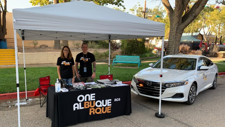 Two Albuquerque Community Safety staff members at a recruitment event.