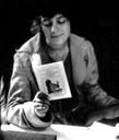 Daphne Cobb reading a Kodak manual, ca. 1920