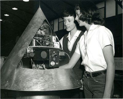 Sandra Tucker and Judy Sesock work with their satellite nose cone prototype project at Jackson Junior High School in 1960.