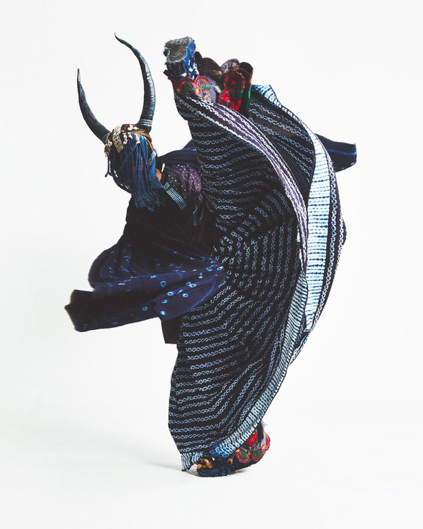 Indelible Blue: Indigo Across the Globe. Laura Anderson Barbata, Rolling Calf, 2015, hand-woven indigo-dyed cotton textile by Habibou Coulibaly, courtesy of L'Aviva Home; indigo-dyed cotton brocade, printed cotton, machine embroidery from Oaxaca, decorated sneakers, natural fiber basket, buttons, fabric-maché, leather, character from Intervention: Indigo, photo by Rene Cervantes, courtesy of the artist