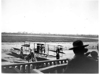 Charles Walsh's Curtiss Biplane at the Territorial Fair Race Track (Speed Ring), 1911. Territorial Fair Grounds, Old Town, Albuquerque. The Albuquerque Museum Photoarchives. Gift of George Pearl, 1978.1.13.