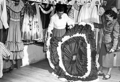 Fiesta dresses at the Old Town Costume Shop, 1951.  Photographer: Harvey Caplin, Albuquerque Progress Collection, 1980.186.555.