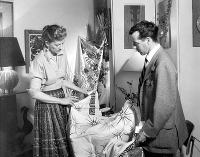 Designer Robert Klein showing fabric to Peggy Hooton in Old Town, 1951.  Albuquerque Progress Collection, 1980.186.556