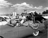 La Reina Charlotte Goodwin (right) and La Princesa Maxine Hill at the Albuquerque Airport.  Albuquerque's 250th Anniversary, 1956.  Milo Crawford Collection, 1994.12.1.