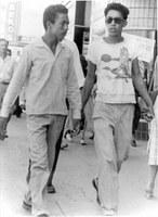 Richard Baca and Fernie Espinosa, downtown Albuquerque, 1951.  Baca-Jaramillo Collection, 1998.9.5.  Both boys sport fashionable pompadours.