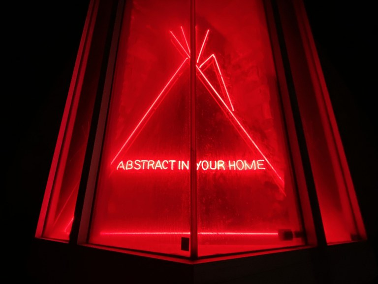 Red neon tepee with words, ABSTRACT IN YOUR HOME