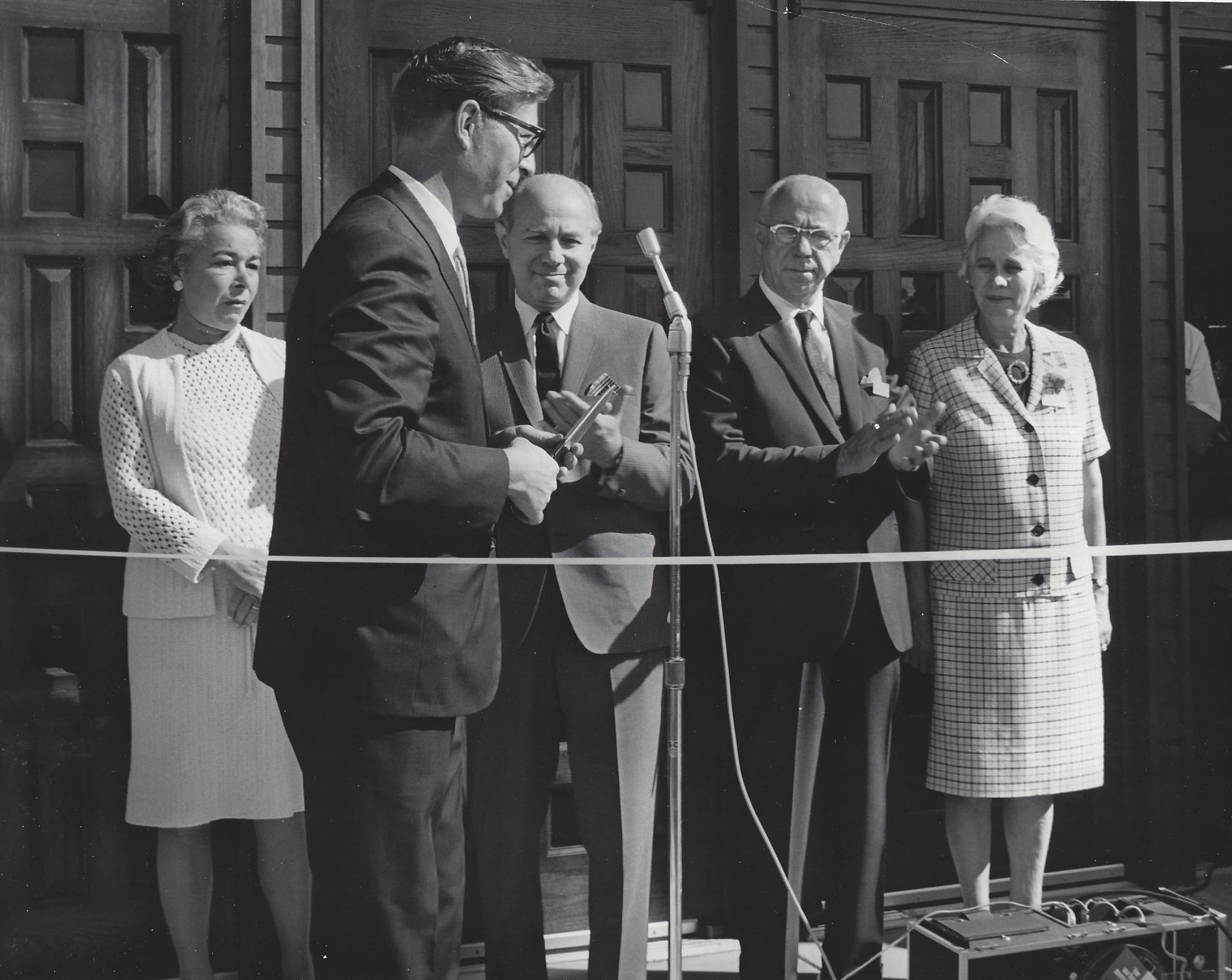 Ribbon cutting for American Furniture store at Menaul and Carlisle in 1968 with Pete Domenici in front of (from left to right): Frieda Blaugrund, wife of E. Mannie; E. Mannie Blaugrund; Henry Blaugrund; Ruth, wife of Henry.