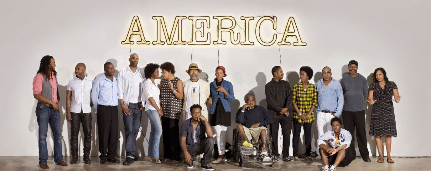 Artists from the exhibition in front of Glenn Ligon's America, 2008, courtesy Rubell Family Collection, Miami