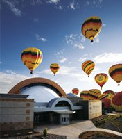 The Anderson-Abruzzo Albuquerque International Balloon Museum flanked with balloons.