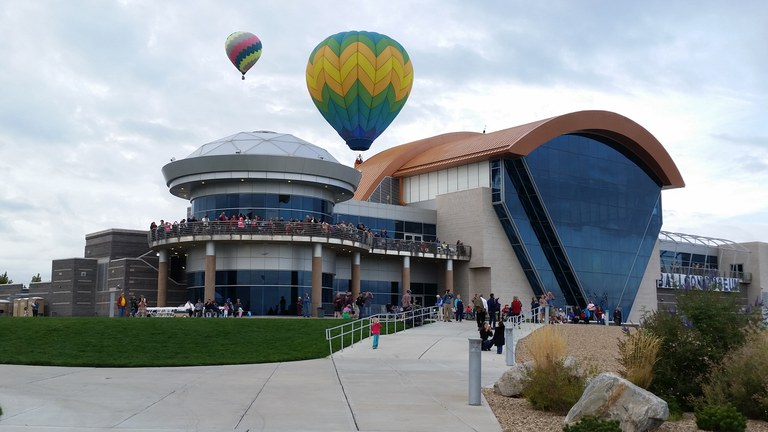 Balloons take flight above the Balloon Museum.