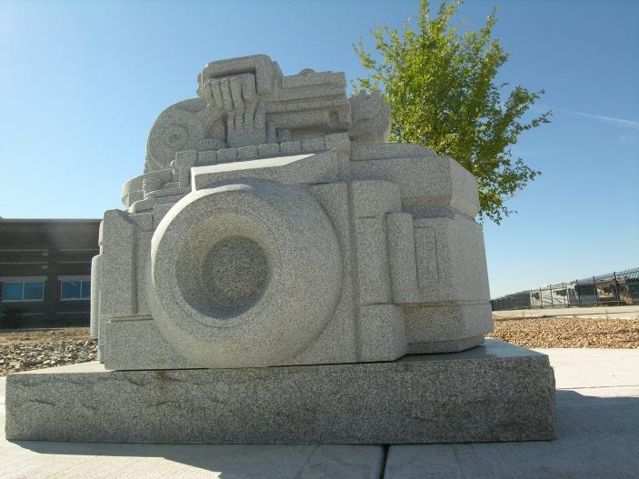 A statue of a camera