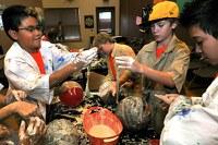 caption:Camp BioPark Students help prepare animal enrichment.