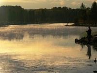 A fisherman enjoys the solitude of morning at Tingley Beach