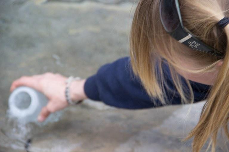Jenn in polar bears collecting water sample.