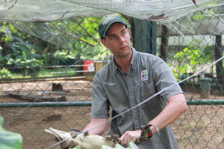 Matt Eschenbrenner with a juvenile crocodile at Zoo National d'Abidjan in 2017.
