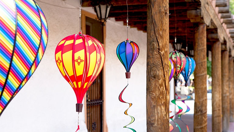 Wind sock balloons hanging from vigas in Historic Old Town.