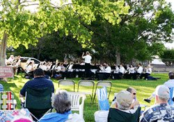 Image of the Albuquerque Concert Band performing for its summertime park series, sponsored by the City of Albuquerque.