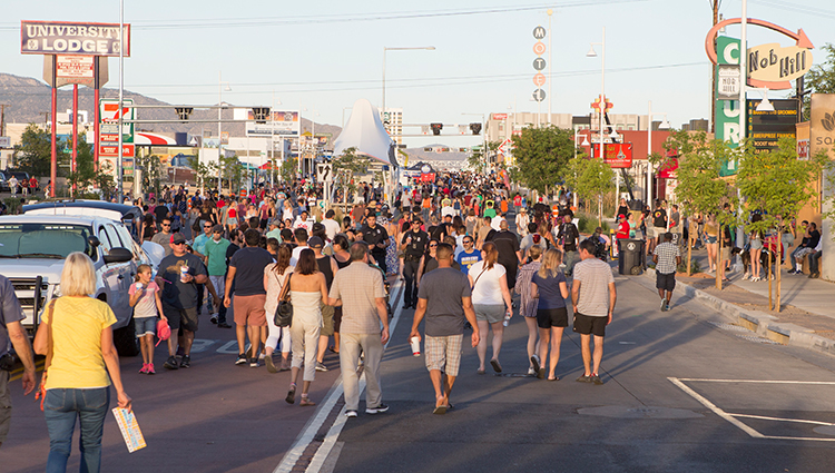 A Crowd of People Walking Down Central in the Nob Hill Area