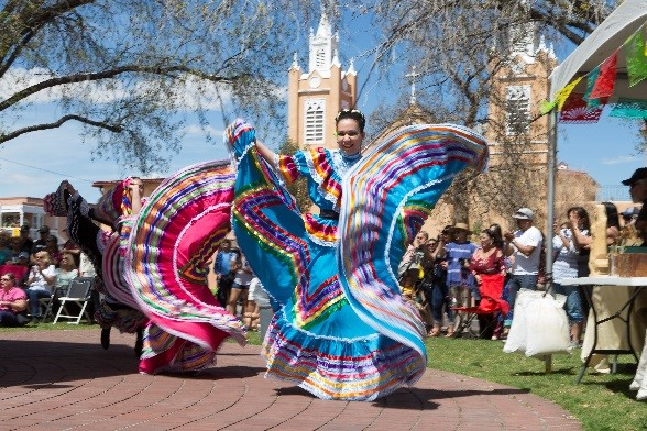 A photo of two dancers performing at historic Old Town.