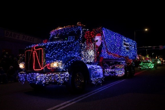 A photo of a semi truck at the Twinkle Light Parade