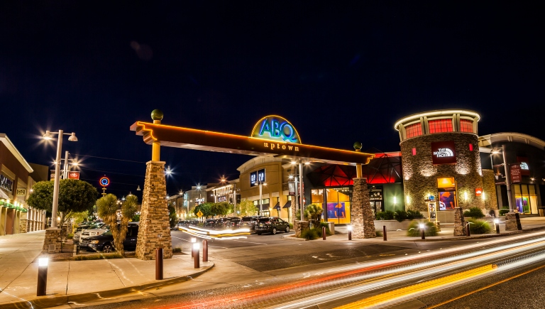 A photo of Albuquerque Uptown taken at night.