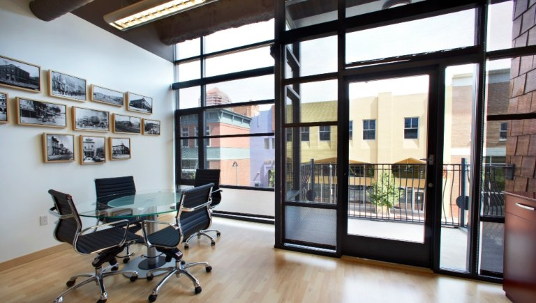 A photo of conference room with windows.