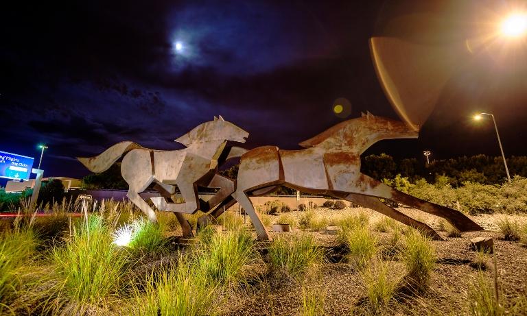 A bronze statue of metal horses