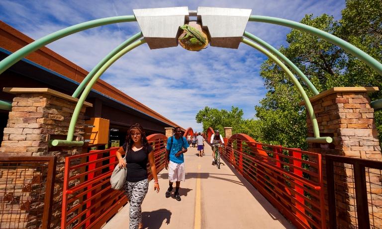 Pedestrians crossing the Rio Grande River via a bridge