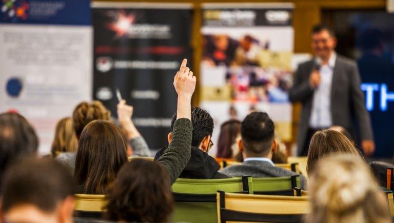 Presentation with Hand Raised