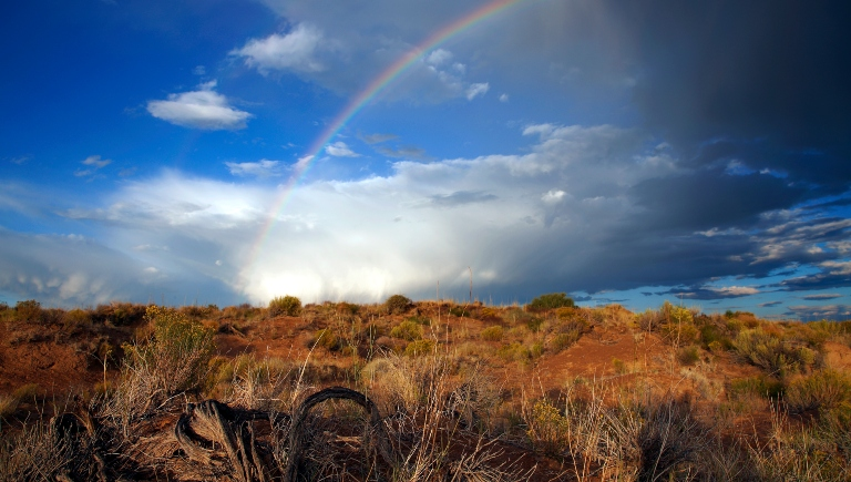 A photo of a rainbow of over the mesa.