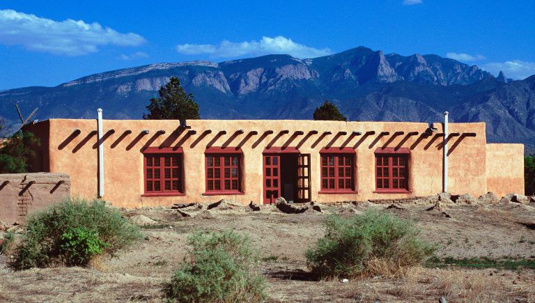Stucco Building in Front of Sandias