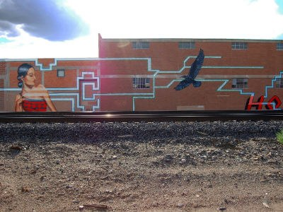 Image of ABQ public art near railroad tracks.