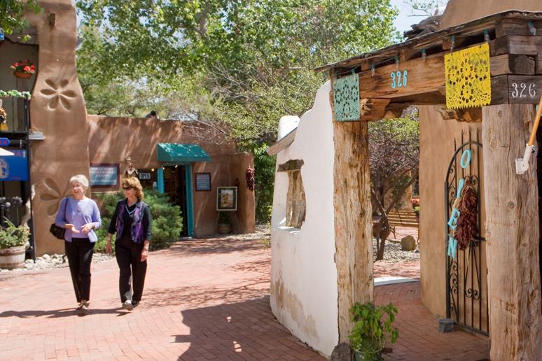 A photo of two senior women walking through Old Town Albuquerque.