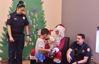City Councilors Trudy Jones and Brad Winter Joined Albuquerque Fire Rescue and the Woodworker's Association to Deliver Gifts to CLN Kids