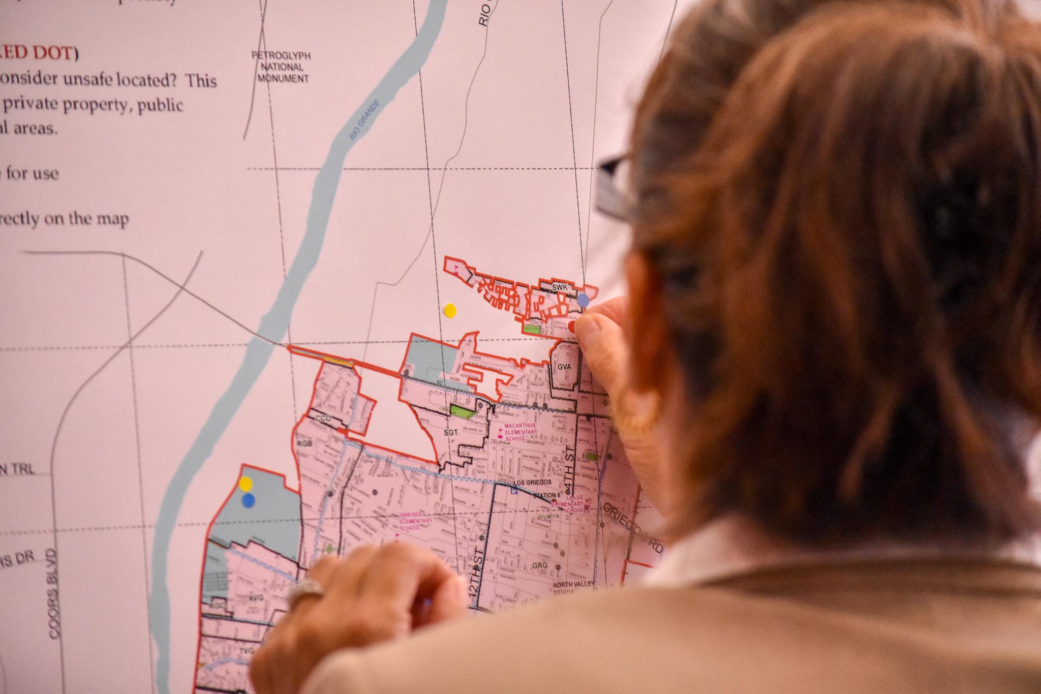 Woman marking map.