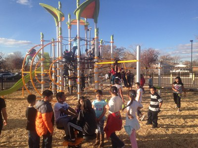 caption:Kids playing on the new playground