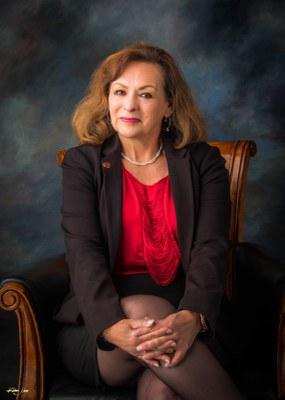 Councilor Cynthia Borrego sitting in a chair.