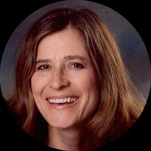 A headshot of Carol Pierce