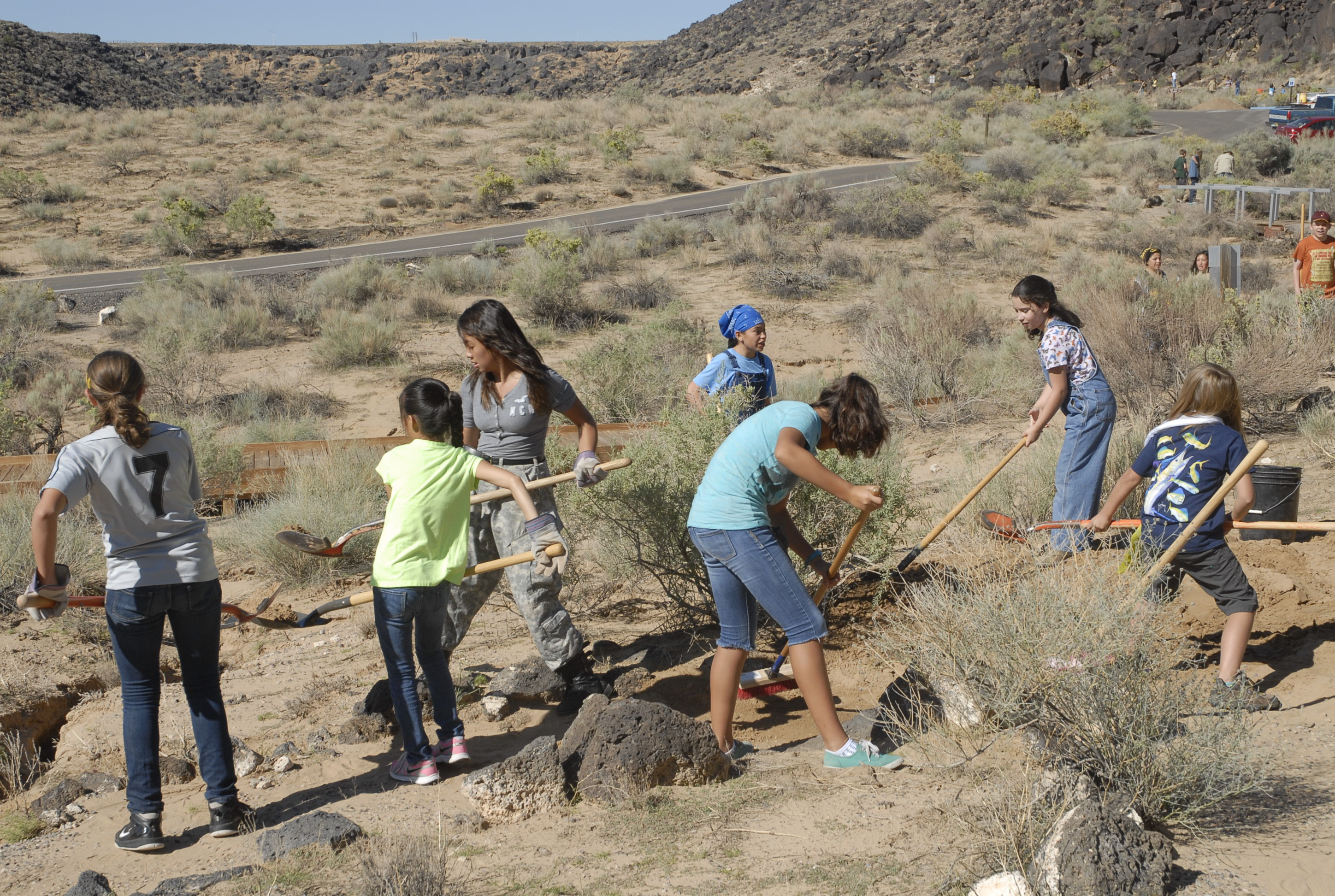A team of volunteers cleaning up a trail.