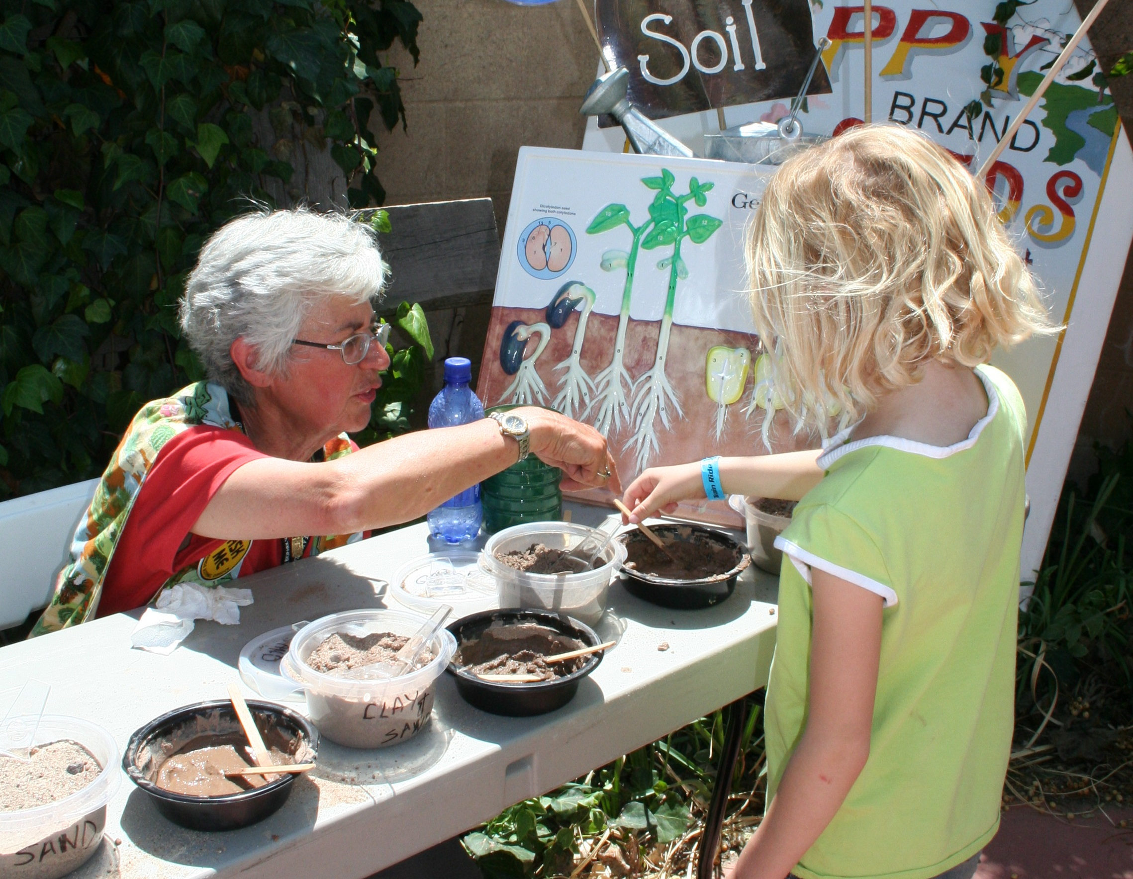 A BioPark employee and a child talking about seeds.