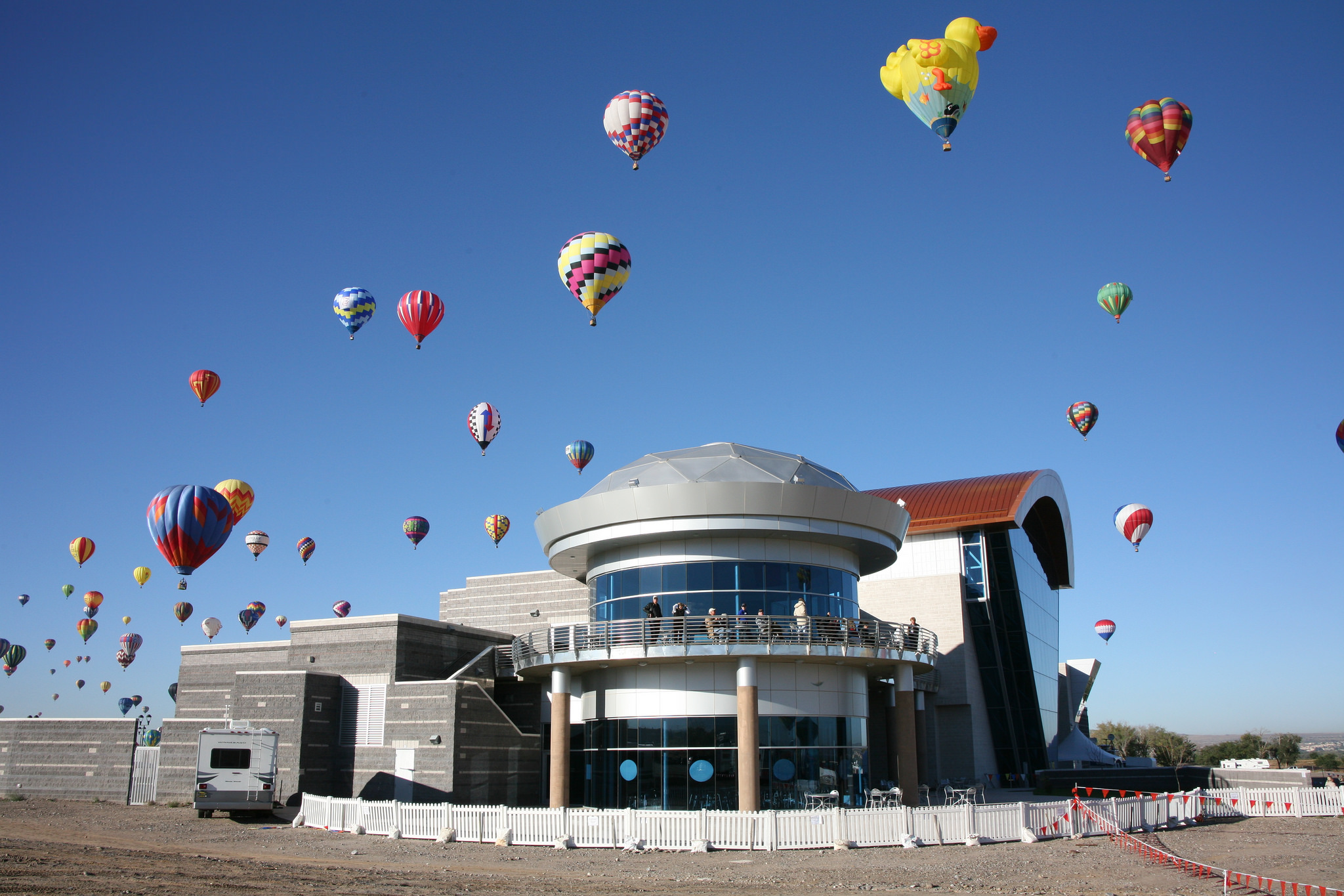 The Anderson Abruzzo Albuquerque International Balloon Museum with balloons overhead