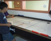 Children playing air hockey