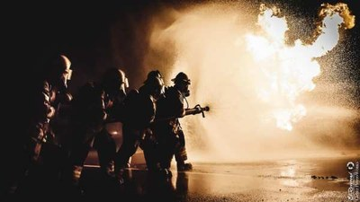 An image of firefighters working at night.