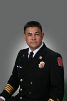 caption: Assistant Chief Gilbert Santistevan