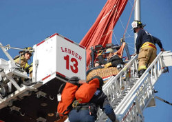 The Albuquerque Fire Department rescues four trapped balloonists on March 26, 2010, after their gondola became entangled with a light pole. The balloonists were trapped 30 feet off the ground. Photo by AFD Photographer Joseph C. Stone.