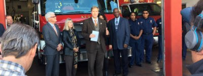 An image of Mayor Keller at a press conference outside a fire station.