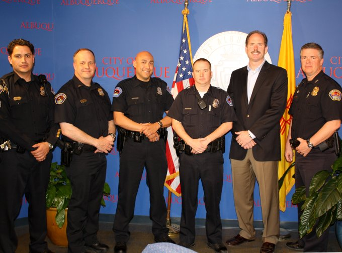From left: Sgt. Dennis Barela, Lt. Jay Gilhooly, Det. Shawn Casaus, Det. Andrew Wickline, Mayor Richard Berry, Chief Ray Schultz.