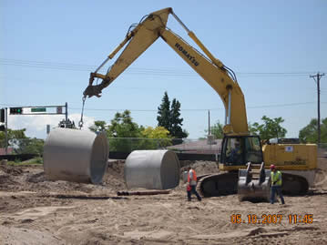 Tingley Park Laying Down Giant Drain Pipes