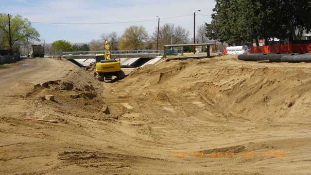 Removing concrete lining east of comanche bridge